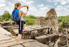 Tourist taking picture of the ruins Pre Rup, Angkor, Cambodia Stock Photos