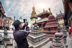 Tourist taking picture of stupa Royalty Free Stock Photo
