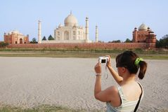 Tourist taking picture of Taj Mahal royalty free stock photography