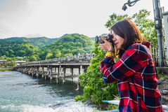 Tourist taking picture at Togetsu-kyo Bridge in Arashiyama distr Royalty Free Stock Photography