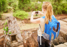 Tourist taking picture from top of Pre Rup, Angkor, Cambodia Royalty Free Stock Photo