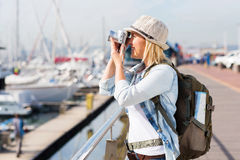 Tourist taking pictures harbour Stock Image