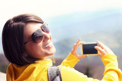 Tourist taking pictures in the mountains Royalty Free Stock Photography