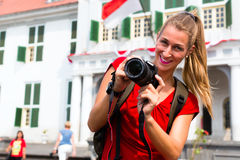 Tourist taking pictures in old batavia district ofjakarta Royalty Free Stock Image