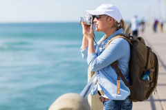 Tourist taking pictures pier Stock Photography