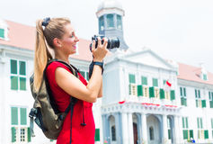 Tourist taking pictures sightseeing in Jakarta, Indonesia Royalty Free Stock Photos