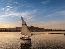 Tourist taking a ride in a Felucca boat in Luxor Egypt on the NIle River stock photo