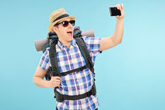 Tourist taking a selfie with cell phone Royalty Free Stock Photography