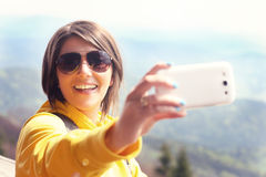 Tourist taking selfie in the mountains Stock Photography