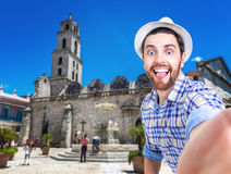 Tourist taking a selfie photo in Havana, Cuba (San Francisco Square) Stock Image
