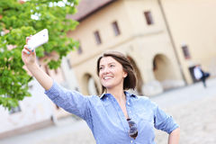 Tourist taking selfie in a town Royalty Free Stock Image