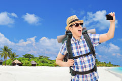 Tourist taking selfie at a tropical beach Royalty Free Stock Images