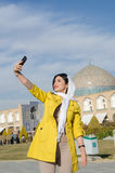 Tourist taking selfie. A woman tourist taking a selfie of herself in Iran Royalty Free Stock Photo