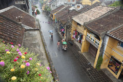 Tourist taking a tour to discover Hoi An ancient town by cyclo on a rainy day Stock Photography