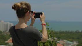 Tourist taking travel picture with phone during summer holidays. Unrecognizable female young adult enjoying in Asia. stock video