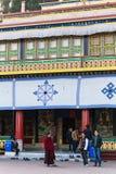 Tourist talk with Tibetan monk in front of Rumtek Monastery in winter near Gangtok. Sikkim, India Stock Images