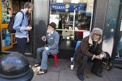 Tourist talking with local homeless on Brick Lane Stock Photography