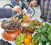 Tourist tastes artisan olives Stock Photo