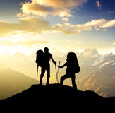 Tourist team. On the mountain top. Sport and active life concept Royalty Free Stock Photos