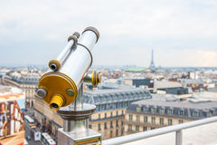 Tourist telescope over Paris landscape on Lafayette Gallery Stock Photo