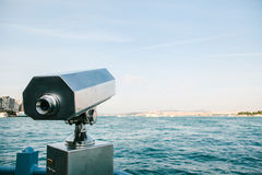 Tourist telescope with scenic view of the sea and blue skies. View of the Bosphorus, Istanbul, Turkey. Tourist telescope with scenic view of the sea and blue Royalty Free Stock Photo
