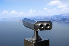 Tourist telescope with scenic view of the sea and blue skies Stock Photo