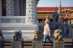 Tourist in the temple in Bangkok royalty free stock image