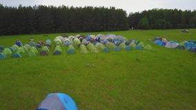 Tourist tent with beautiful sunset background. Children`s tent amid sky and travel. Children`s campsite. Children`s camp stock video footage