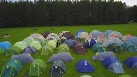Tourist tent with beautiful sunset background. Children`s tent amid sky and travel. Children`s campsite. Children`s camp. And tents 4K stock video footage