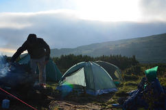 Tourist tent in camp among meadow in the mountain at sunrise stock photos