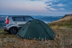 Tourist tent and car in the open air. Ukraine. stock image