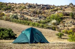 A tourist tent. Close-up green tourist tent at wild nature Royalty Free Stock Photos
