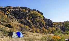 A tourist tent. Close-up green tourist tent at wild nature Royalty Free Stock Photo