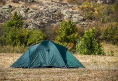 A tourist tent. Close-up green tourist tent at wild nature Royalty Free Stock Photography
