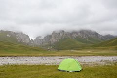 Tourist tent in field camp among montains. Mist, tend, field Stock Image