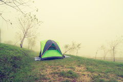 Tourist tent in the fog Stock Photos