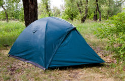 Tourist tent in forest Stock Photo