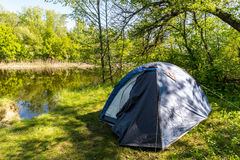 Tourist tent in forest Royalty Free Stock Photo