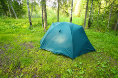 Tourist tent on glade in wood Stock Photos