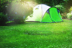 Tourist tent on green meadow Stock Image