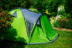 Tourist tent on green meadow Royalty Free Stock Photos