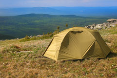 Tourist tent on hill in mountains Royalty Free Stock Photography