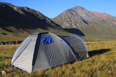Tourist tent in a mountain landscape Stock Photography