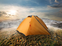 Tourist tent in mountains Stock Image