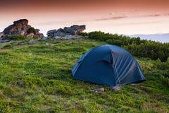 Tourist tent in mountains Stock Photo