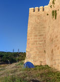 Tourist tent near wall of Naryn-Kala fortress. Derbent Royalty Free Stock Photography