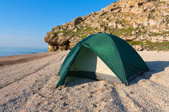 Tourist tent on sea beach Stock Photos