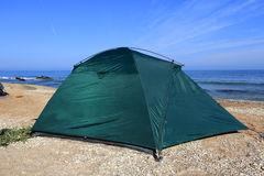 Tourist tent on sea Royalty Free Stock Image