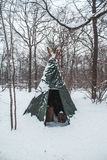 Tourist tent set in a winter snowy field stock images