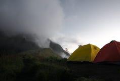 Tourist tents on the foggy mountain Stock Photos